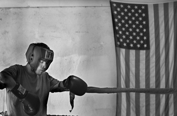 "ROBERT SUMNER / HERALD NEWS STAFF PHOTOGRAPHER 08.0904 Jose Mazariegos, 16, rests while sparing at the Joliet Boxing Club. By-Rite Furniture on Cass Street gives the club its home on its third floor. The club was originally started by Ben Moreno, in 1976, as a way to keep kids off the street. Today his son, Thomas ""Boo"" Moreno, is one of the coaches. He has tried to help kids such as Jose stay in school and learn discipline and respect."