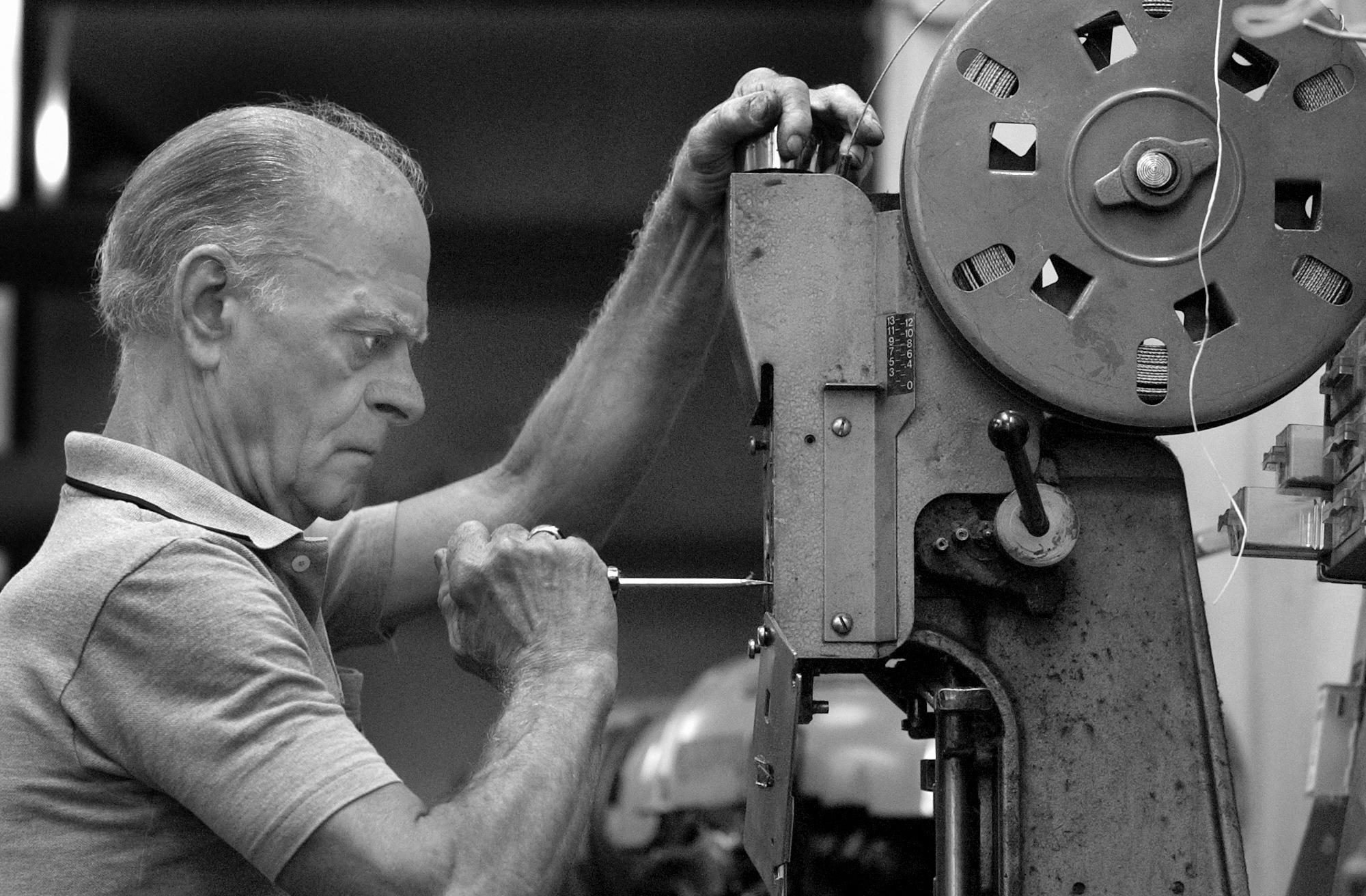 ROBERT SUMNER / HERALD NEWS STAFF PHOTOGRAPHER 08.24.04 Bob Kwasigroch makes an adjustment to an automatic nailer at Andy's Shoe Repair on East Cass Street in Joliet. He started repairing shoes when he was 17. His father, Andy Kwasigroch, started the business at The White Store, shining shoes when he was 15.